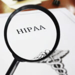 HIPAA healthcare document with magnifying glass